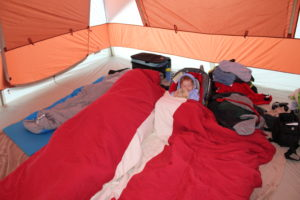 baby sleeping in a car seat in a tent