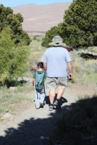 daddy and son hiking together