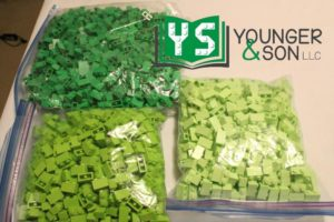 storage bags of green, lime and yellowish green 1x2 bricks