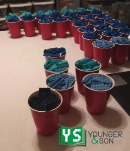 cups full of blue LEGO