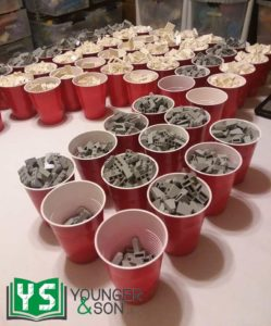 cups full of grey LEGO