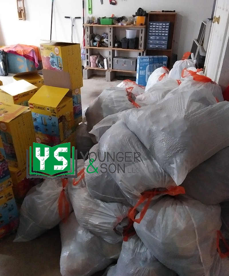 pile of bags with LEGO boxes
